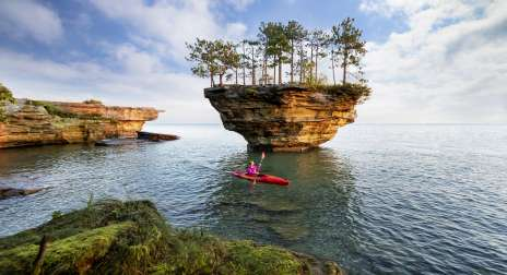 Kayaker in waters around Turnip Rock.
