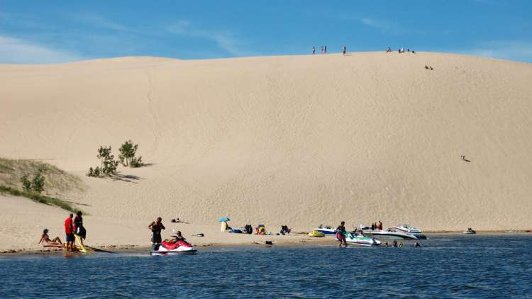 climbing and riding silver lake sand dunes