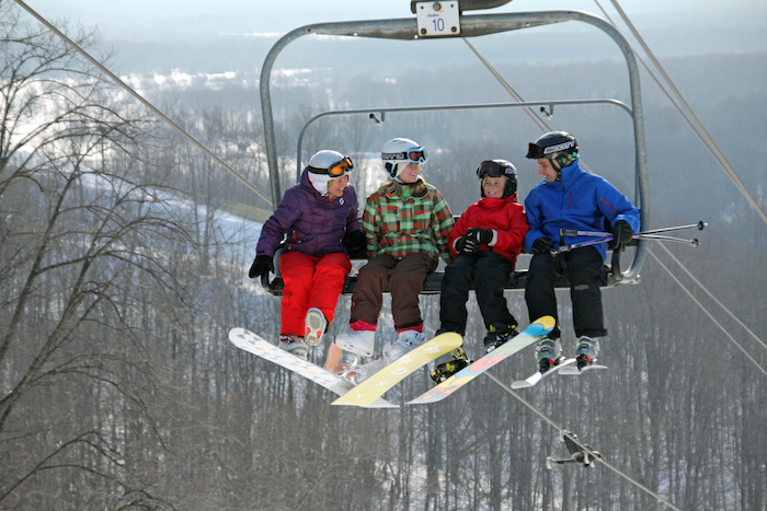 Family in chairlift at Crystal Mountain