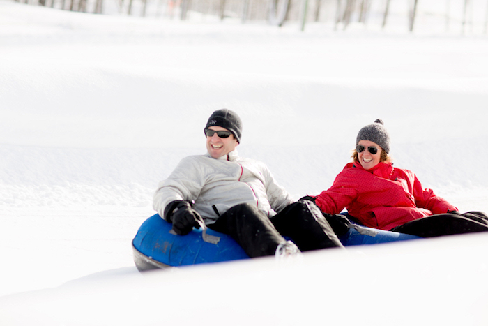 Couple snow tubing togehter