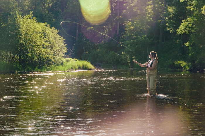 Fly fishing in the Au Sable River in Grayling