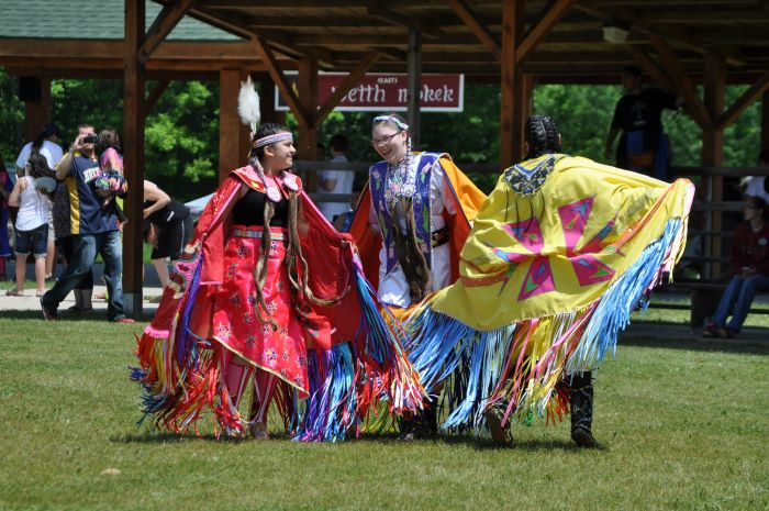 Teens dancing in traditional clothing at Great Lakes Area Traditional Pow Wow