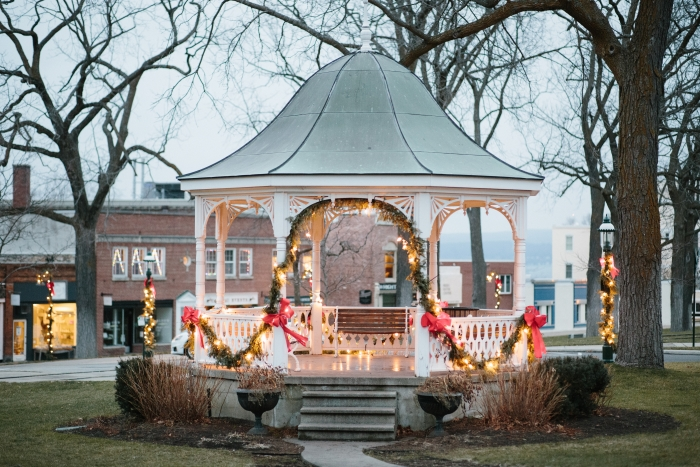 A gazebo in Petoskey decorated with garland.