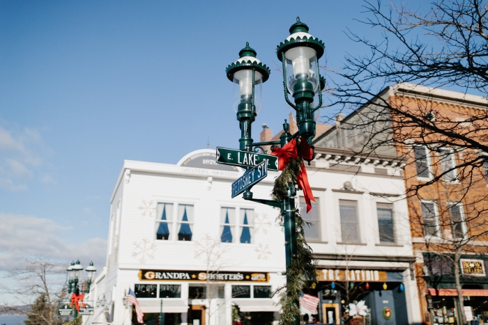 Streetlamp on corner decorated with garland in downtown Petoskey.