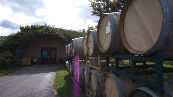 Wine barrels outside wine cellar at Black Star Farms