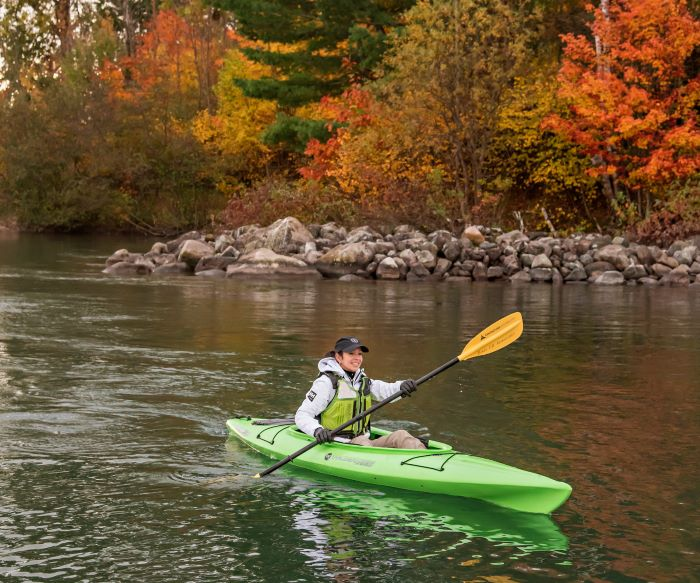 Woman kayaking on the St. Marys River during fall
