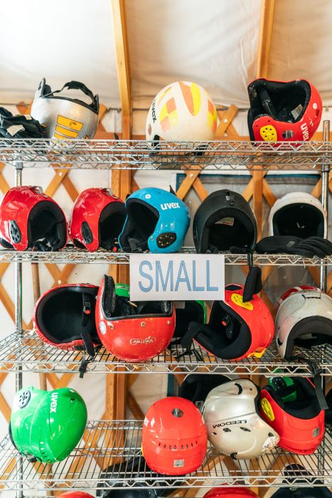 Rental helmets on shelf at the Muskegon Winter Sports Complex.
