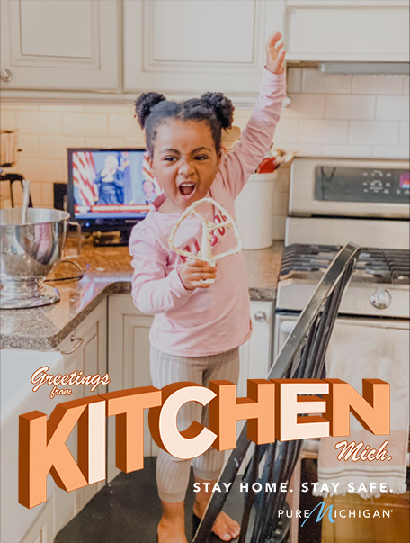 "Little Girl in Kitchen with text that reads ""Greetings from Kitchen, Michigan."""