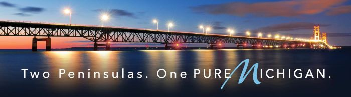 "Mackinac Bridge Billboard that reads ""Two Peninsulas, One Pure Michigan."""
