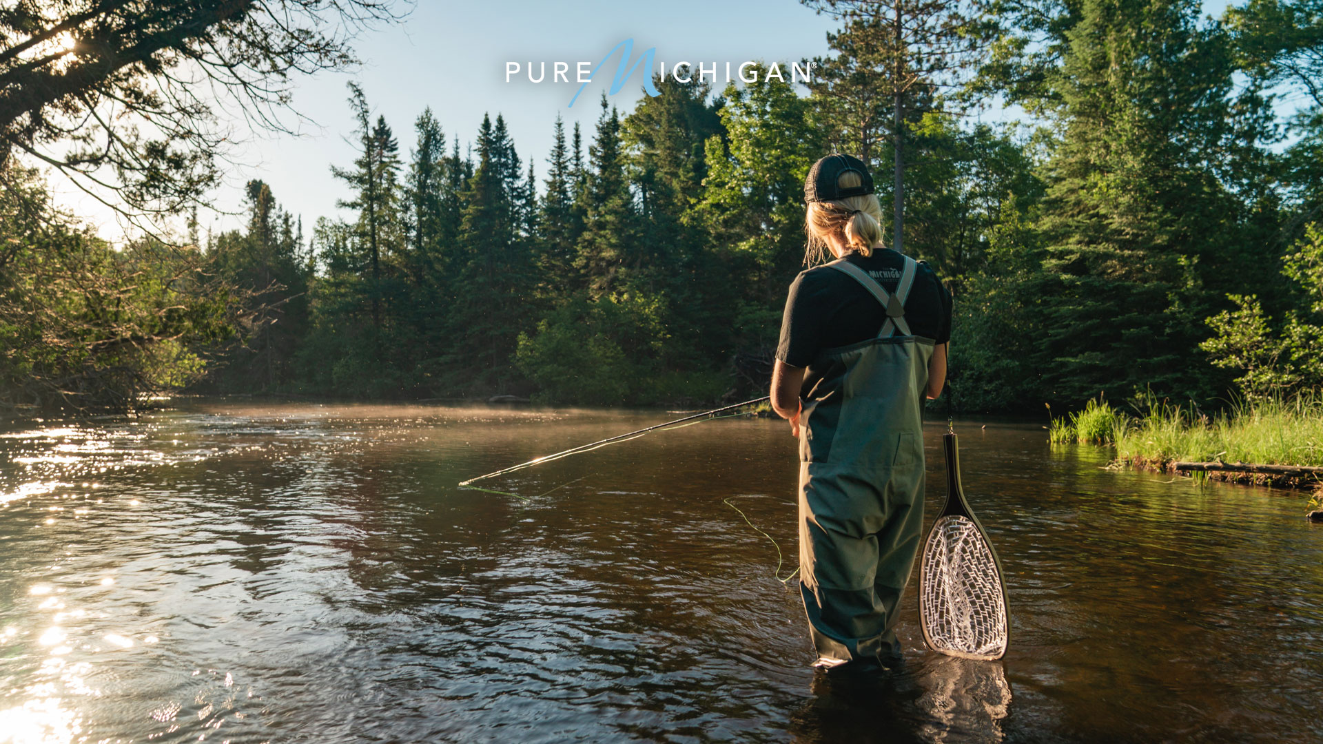 Woman fly fishing on the Au Sable River