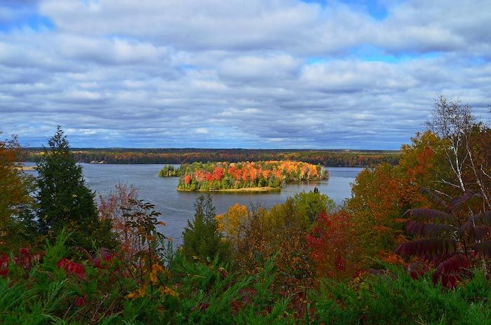 Au Sable River by Lumberman's Monument during fall